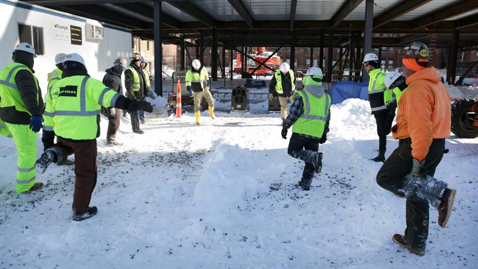 Gilbane Construction workers braved the cold weather while on a construction site on Parker Street in Boston on Friday.